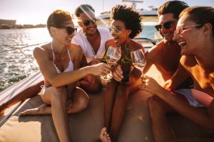 Multiracial,Group,Of,People,Toasting,Drinks,On,The,Yacht,Deck